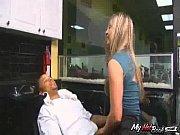 Malia Kelly has long blonde hair, a belly piercin