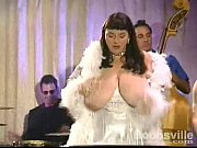 Picture Candye Kane sings and plays the keyboards wi...