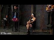 Девушка в чулках и мини платье одна на шпильках в кресле