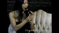 Tia Ling Enjoys a BLACK GIANT Cigar