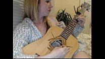Freckles camgirl playing her guitar half naked Live69Girls.Com porn videos