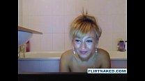 Hot blonde girl having fun in the shower