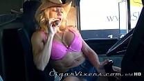 Mandy K SMOKES a cigar