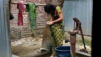 desi girl bathing outdoor for more visit http:/...