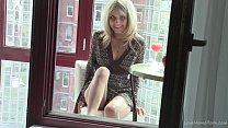Natural blonde masturbating on the balcony