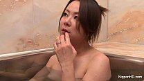 Asian girl fingers her pussy
