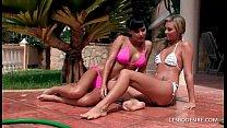 Stunning lesbian teens strip off their wet biki...