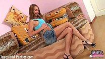 Teen Valya in a tiny jean miniskirt