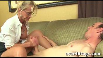 Busty blonde milf gives a wet handjob