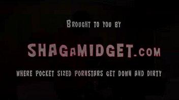 Midget gives a standing blowjob