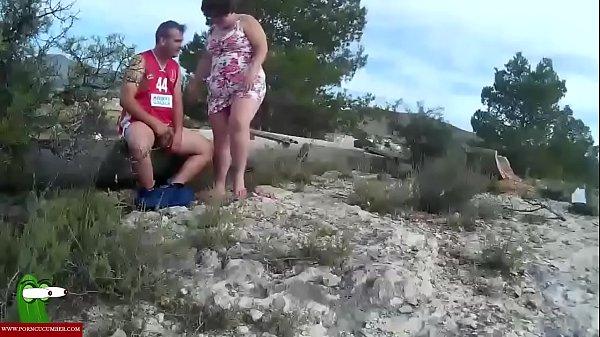 She sucks his cock near the irrigation ditch. SAN128