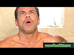 Busty japanese masseuse gives nuru massage and ...