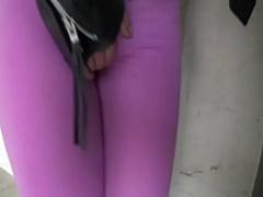 Blond girl pees her spandex leggings outside
