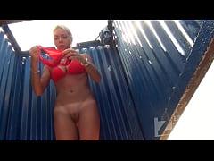 Tanned blonde in a beach cabin