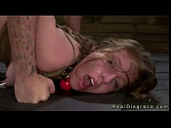 Busty brunette gags on dick in bdsm