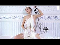 Busty Buffy soaking in hot tub