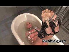 Tied legs busty blonde lowered in water