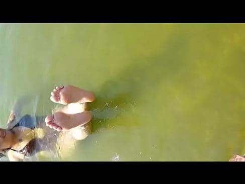 Feet Dangling In The Water