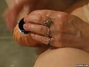 Picture Granny masturbates with a vibrator in bathtu