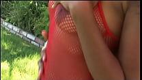 Ebony slut in red fucked outdoors