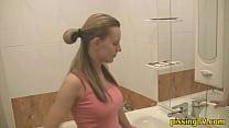 Girl pisses sitting in the toilet