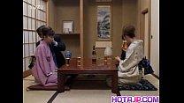 Japanese milfs sticks cock in her cunt next to ...